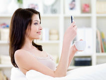 Woman reading a messege on the phone Stock Photos