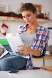Woman reading mgazine In kitchen at home Royalty Free Stock Photography
