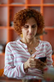 Woman reading on mobile phone Stock Photo