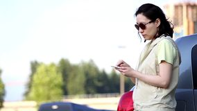 Woman reading mobile phone message stock footage