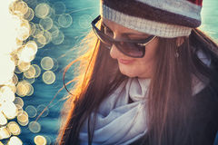 Woman reading near the sea on a nice day, bokeh background Royalty Free Stock Photo