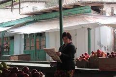 Woman reading the news Stock Photos
