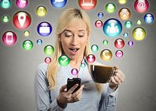 Woman reading news on smart phone Stock Photos