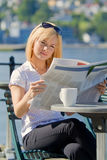 Woman reading a newspaper Stock Image