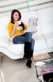 Woman reading the newspaper Stock Images