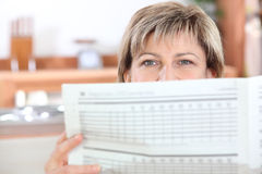 Woman reading the newspaper Stock Photography