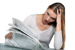 Woman reading a newspaper Stock Photos