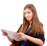 Woman reading newspaper. Businesswoman reading a newspaper  isolated on white background Stock Photography
