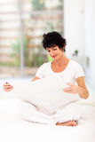 Woman reading newspaper Stock Photos