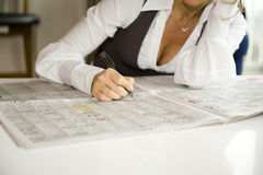 Woman reading newspaper Stock Image