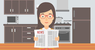 Woman reading newspaper. Royalty Free Stock Image