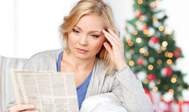 Woman reading newspaper at christmas Royalty Free Stock Images