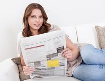 Woman reading the newspaper Royalty Free Stock Image