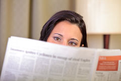 Woman reading newspaper at home Stock Photos