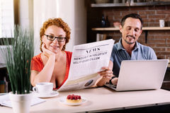 Woman reading newspaper in the kitchen Royalty Free Stock Images