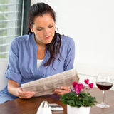 Woman reading newspaper relaxing wine living room Royalty Free Stock Photography