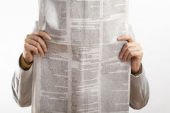 Woman reading newspaper on white background. Woman reading newspaper  on white background Stock Photography