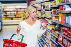 Woman reading nutritional values. At supermarket royalty free stock photos