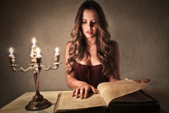 Woman reading an old book Stock Image
