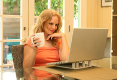 Woman Reading Online royalty free stock photo