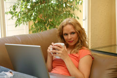 Woman Reading Online Royalty Free Stock Images
