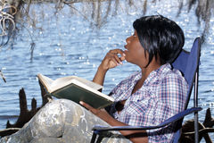 Woman Reading Outdoors (1) Royalty Free Stock Images