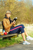 Woman Reading Outdoors Stock Photography