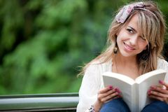 Woman reading outdoors Royalty Free Stock Images