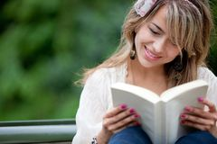Woman reading outdoors Stock Photos