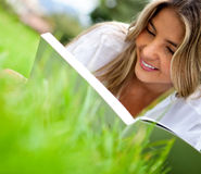Woman reading outdoors Stock Image
