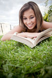 Woman reading outdoors Royalty Free Stock Image