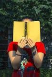 Woman reading outdoors Stock Photo