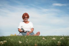 Woman reading outside Royalty Free Stock Image