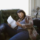 Woman reading paper. Royalty Free Stock Photography