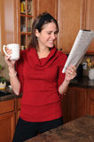 Woman Reading the Paper Royalty Free Stock Photography
