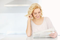 Woman reading paper in the morning Royalty Free Stock Images