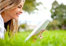 Woman reading at the park Stock Photography