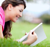 Woman reading at the park Stock Photos