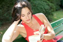 Woman reading in a park Royalty Free Stock Image