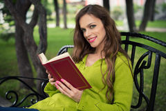 Woman Reading in the Park Stock Images