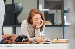 Woman reading a phone message Stock Photo