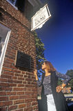 Woman Reading Plaque on Star Spangled Banner Flag House, Baltimore, Maryland Stock Images