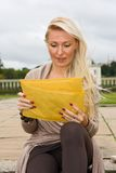 Woman reading post Royalty Free Stock Images