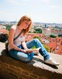 Woman reading in Prague Stock Photos
