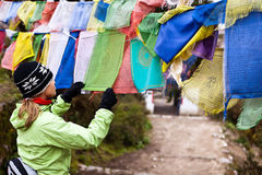 Woman reading prayers flag in Nepal Stock Images