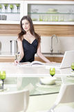 Woman reading recipe book Royalty Free Stock Photography