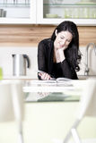 Woman reading recipe book Royalty Free Stock Image