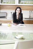 Woman reading recipe book Royalty Free Stock Images