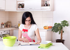 Woman reading recipe Stock Photography