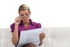 Woman reading a report Royalty Free Stock Image